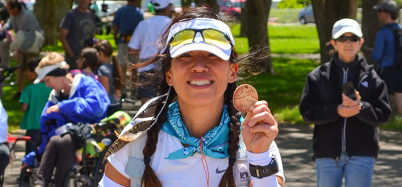 Jenny at the Wild Wild West finish line with her medal!